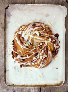 A recipe by Paul Hollywood, this apricot couronne is a real showstopper. The sweet bread is twisted into a circle of apricots, orange zest, walnuts and raisins. British Baking Show Recipes, British Bake Off Recipes, Great British Bake Off, Baking Recipes, Dessert Recipes, Bread Recipes, Cafe Recipes, Fun Recipes, Baking Ideas
