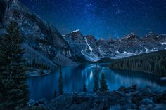 By day, the gorgeous scenery of the Canadian Rockies. By night, a sea of stars, mirrored on the glasslike waters of Moraine Lake.  47 Of The Last Places On The Planet To Witness The Night Sky As Nature Intended