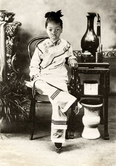 I find this fascinating since this girl appears to be of African decent based on bone structure, facial features and hair, but is in oroental clothing with bound feet.   Lotus Feet (Zakia as Chinese girl with bound feet)  by Elena Kalis