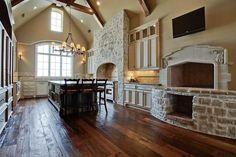 This is someone's kitchen, WOW - stone, beams, floors & fireplace