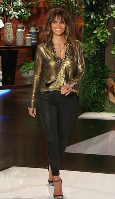 The stunning Halle Berry looked remarkable in a gold tone top, black pants and open toe sandals while on the Ellen Show