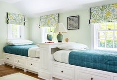 Two twin beds along one wall with extra storage