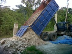 Dumping another load of fill - 30 cubic yards - in preparation for driveway.