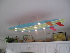 Surf board ceiling light. By color infusion.