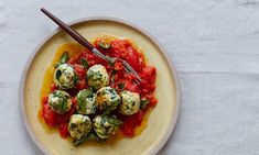 Thomasina Miers' ricotta, courgette and spinach dumplings with tomato sauce.