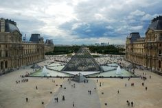 Pyramid and Pavillon Rishelieu in Louvre Paris. Louvre is the biggest Museum in Paris displayed over 60,000 square meters of exhibition space.