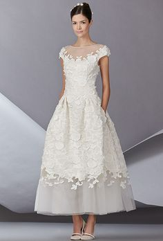 If you want texture and a bit of whimsy, then this gown holds both a princess style and one that can be swept away for a destination ceremony.