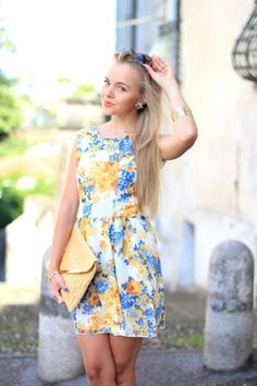 Yellow and blue floral print dress with a high neckline, yellow tweed envelope clutch, and gold bangles. SO CUTE!