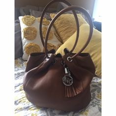"""⁉️ MICHAEL KORS BUCKET BAG Authentic textured brown, Michael Kors bucket bag in like-new condition! Photo of date tag to prove authenticity! 8in handles, magnet closure, a few pen marks on the inside of the bag. Multiple interior compartments! Great """"catch all"""" bag. ✨ Need to clean out my closet! Bundle offers preferred! Michael Kors Bags Shoulder Bags"""
