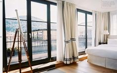 Black frame and long curtains.. For a master bedroom?
