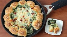 Break off a piece of cheese-filled pizza crust and scoop up some hot spinach, chicken and sun-dried tomato dip.