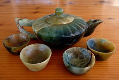 "A very old vintage Dynasty Chinese jade teapot and tea cups set.   Purchased during my first shopping trip in 200 in China from a government jade museum near Xinjiang where jade has been mined and carved for centuries. The history is that it was carved in the 19th century.  This jade is like the ""river jade"" that gets the deep green, honey and charcoal from the river where the jade is mined, so it is genuine and natural color jade.  The jade teapot and cups were well polished and still look… Tea Pot Set, Teapots And Cups, Cupping Set, Hand Carved, Jade, Tea Cups, Chinese, Carving, 19th Century"