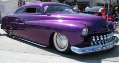 Now all it needs is a powercat - low riding vintage car, shining Purple Pride, EMAW!!