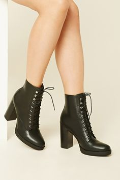 A pair of ankle booties crafted from faux leather featuring a lace-up front, a chunky heel, and a slightly pointed toe.