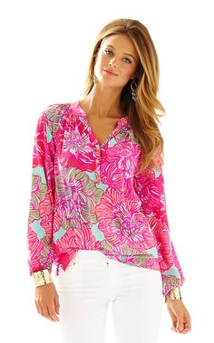 Get ready for a style epiphany: this silk blouse is the secret workhorse of your closet. You can wear the Elsa Top - Worth It tucked in or worn out, sleeves pushed up or blissfully long, styled with a belt over leggings, peeking out from under a blazer, draped over the top of a pencil skirt...Elsa is one shirt with an endless number of looks year-round. This season, we're making Elsa's job a little easier by bringing you bright new prints and colors to spice up your collection.