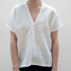 ALMA EVA white, a plain V neck top in a loose boxy fit. Also comes in charcoal.