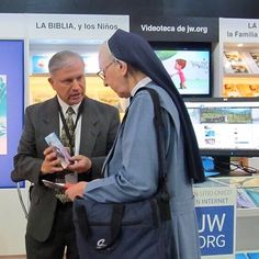 Sharing the good news at the JW booth at a book fair in Santiago, Chile. Photo shared by Happy People, My People, Public Witnessing, Jw Humor, Jehovah S Witnesses, Jehovah Witness, Matthew 24, Bible Truth, Heavenly Father
