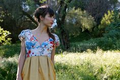 Lola dress - colorful floral print, golden yellow pleated skirt.