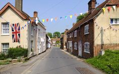 Proud lines: The bunting in East Isley zig zags across the village and along the rows of pretty cottages to celebrate a Great British summer