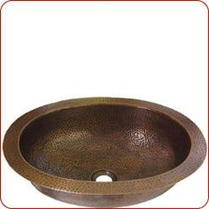 Hand hammered copper sink decorated with grape hammer motifs.  Measures 18