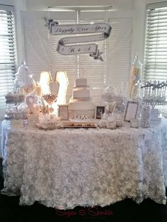 Glam white and silver engagement party dessert table!  See more party planning ideas at CatchMyParty.com!