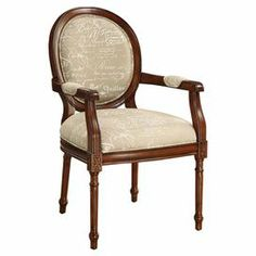 Featuring a hand-carved frame and fluted legs, this beautiful arm chair adds a touch of Parisian style with French script-print upholstery and a classic oval back.     Product: ChairConstruction Material: Wood and fabricColor: Coverly brown and beigeFeatures: Hand-carved frameDimensions: 39.5'' H x 24.25'' W x 26.75'' D