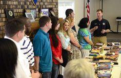 Tornado relief volunteers donate 300 books to DREAM