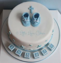 Little Love Cakes: Boys christening cake with tiny booties
