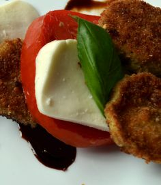 If you ever want the flavors of summer on a plate, this is the dish!  It is beautifully balanced.  Baby eggplant is breaded and lightly fried and paired with farm ripened organic tomatoes, fresh mozzarella cheese, fresh basil and drizzled in a beautiful balsamic reduction.