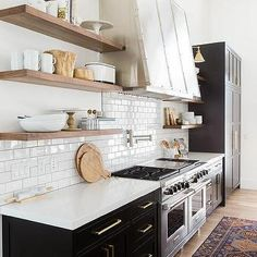 Solid Black Kitchen Cabinets with Natural Brass Edgecliff Pulls