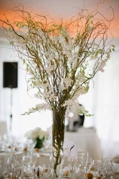Centerpieces-use white flowers but spray branches silver…silk blue ribbon around vases @Jerolyn Finnell