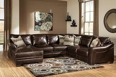 The Beenison 4-Piece Sectional from Ashley Furniture HomeStore (AFHS.com). Upholstery features top-grain leather in the seating areas with skillfully matched DuraBlend® upholstery everywhere else.