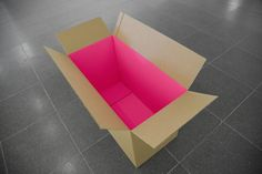 Cardboard box with flouro pink interior