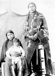 Cree family - 1895 Man in photo is wrapped in Hudson Bay blanket