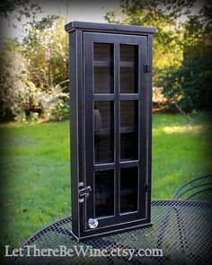 This black distressed cabinet with plexi glass is custom made to store your essential oils or nail polishes in. This black cabinet measures 28 high x 12 wide x 3 deep (its a little deeper because of the crystal knob though). It will easily hold 96 of the 15ml and 5ml essential oil bottles, with ample deep shelves to double up and gives you the perfect way to display your oils or nail polishes. The cabinet has 6 shelves measuring 9 1/2 wide by 1 3/4 deep, and there is over 3 1/2...