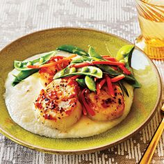 Pair sea scallops with a cauliflower and potato puree for an elegant yet weeknight-friendly meal. Tip: Patting the sea scallops dry before cooking helps ensure a great seared crust.View Recipe: Seared Scallops with Cauliflower Puree Pea Recipes, Pureed Food Recipes, Healthy Recipes, Dinner Recipes, Cauliflower Puree, Cauliflower Recipes, Cauliflower Fritters, Cheesy Cauliflower, Shellfish Recipes
