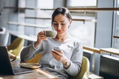 Woman sitting in a cafe drinking coffee and working on a computer Free Photo Free Stock Photos, Free Photos, India Breaking News, Photo Pin, People Change, Coffee Drinks, Drinking Coffee, Current Events, World