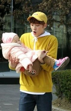 A baby holding a baby Channel V, Astro Kpop Group, Astro Wallpaper, Fandom Kpop, Astro Fandom Name, Holding Baby, Baby Carrying, Pre Debut, Actor