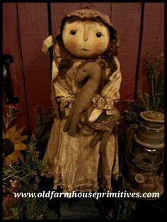 #PC27D Primitive Doll Holding Horse (Made In USA)