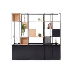 A customizable and modular shelving zone divider with a mid-century modernism style that gives flexibility to today's more transitory workforce. A customizable and modular zone divider that gives flexibility to to. Loft, Office Furniture, Furniture Design, Wooden Furniture, Space Dividers, Metal Grid, Bookshelf Design, Workplace Design, Office Interiors