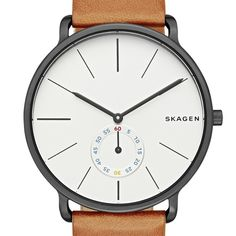 The Hald has a minimal dial with numberless indices to mark the hours and minutes, whilst coloured numerals mark the seconds on a sub-dial. #watches #design