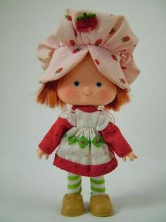 Strawberry Shortcake (no longer looks this sweet) I'm pretty sure she's missing her shoes... her hat is lost with the Barbie stuff, and her hair is halfway gone. Oh well.