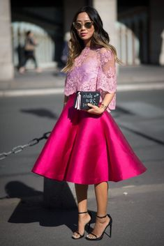 Best #streetstyle @ Spring 2015 Ready-to-Wear #PFW | Aimee Song in a sheer light purple crop top over a satin pink midi skirt, styled with black ankle strap sandals and a matching clutch