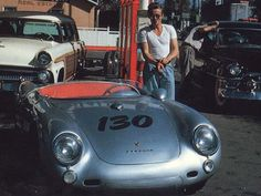 James Dean smoking at a gas station while entering his Porsche, allegedly a few hours before his death in 1955