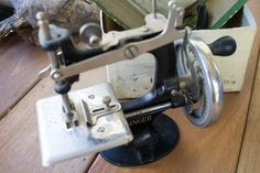 Antique vintage genuine early 1900's Singer Hand Crank child's working sewing machine-cast iron original box instructions needles and clamp by DoubleEweBee on Etsy