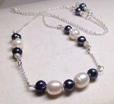 A personal favorite from my Etsy shop https://www.etsy.com/listing/261985996/blue-peacock-and-white-freshwater-pearl