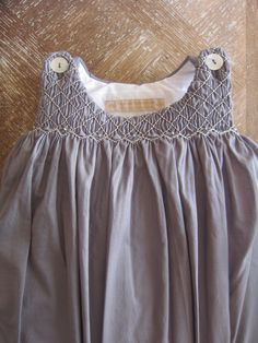 Examples of beautiful smocked clothes.
