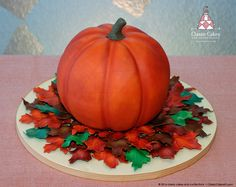 Thanksgiving pumpkin cake with sugar leaves.