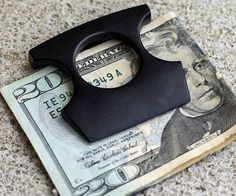 Self Defense Money Clip  Stay prepared for whatever the mean streets throw your way with the self defense money clip. Apart from keeping your dough neatly folded its fitted with an integrated finger hole that lets you use it like brass knuckles  ideal for inflicting pain.  $12.17  Check It Out  Awesome Sht You Can Buy