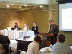 The participating panelists and moderator Michael Roehr, AIA.
